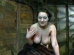 Horny brunette girl gets her big tits twisted with ropes. After that she get her neatly trimmed pussy toyed with a vibrator.