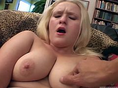 Chubby girl with huge boobs fingers her shaved pussy and then gets fucked doggystyle. Later on the guy sprays his cum all over her face.