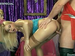 This naughty and super hot blond babe starts from an amazing blowjob. Then he sticks his hyper cock in her tight pussy. After some fucking action he pisses on her.