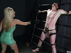 This desirable and smoking hot blond in lingerie is going for that huge cock of her slave. She slaps him and makes him do magic with his tongue!