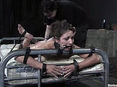 Kinky brown-haired chick Karrlie Dawn is having fun with some guy in a vault. She lets him tie her up to a bed and then enjoys having toys in her juicy snatch.