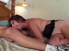 Watch this hot busty brunette milf with big ass and hairy pussy.She always wanted to have sex with younger cock and today her young neighbor boy is around her home.See how she sucks his big young hard cock and gets her hairy pussy drilled hard till he pops his load on her face.