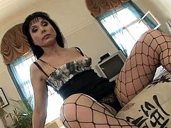 Salacious brunette milf Elena Turenok wearing fishnet pantyhose is having fun with some guy in the living room. She lets toy her snatch and then they bang in side-by-side position on the floor.