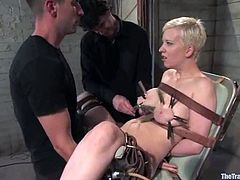 Blonde girl gets her tits whipped. After that she sits down on bondage chair and gets tied up with straps. After that she gets her pussy gaped with claws and toyed.