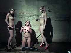 Annette Schwarz, Harmony and one more chick are having fun in a basement. The dominant hotties bind their slave and humiliate her and then attach wires to her ass and fuck her cunt with a dildo.