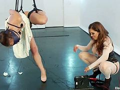Francesca wants to play so she hanged her obedient sex slave, Rose, and started to punish her. Rose hangs tied up in rope, has electrodes all over her body and to make things a bit more interesting, Francesca dildo fucks her from behind. Now that's a shocking experience for such a beautiful slut!