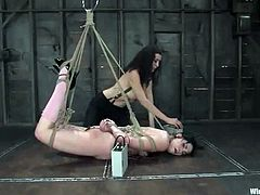 Brunette girl sits on a chair being tied up. She gets her pussy hit with electricity and toyed with a vibrator. Later on she licks her mistress' pussy and gets fucked with a strap-on.