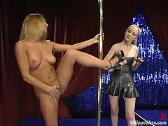 Sexy long-haired blonde Chanta-Rose is having fun with Jenni Lee near a pole. Chanta beats Jenni's tits and ass and they both enjoy it much.