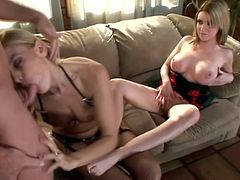 Darryl Hanah and Kelli Kallen are two curvaceous babes in sexy lingerie. They shake booties and then give an amazing blowjob to a lucky man. He also licks their feet because he is a fetishist.