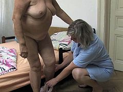 Just look how horny these lesbians are! They rub oil all over each other paying special attention to their big natural tits.