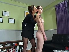 Kym Wilde is going to be a boss for some time and Nina is her secretary! She gets her naked on the first day and then bends her over to slap her ass. Punishment!