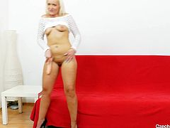 Simira is a Czech cougar that's anxious to take off her panties and offer us her shaved pussy. The blonde plays with her shaved pussy and then grabs a dildo and sucks it to make it nice and slippery. She slides the sex toy between her pussy lips going deeper and deeper in herself. Stick around and see some more!