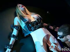 Curvy mommy with big boobs is wearing tight leather corset. She is getting finger fucked in kinky BDSM porn video. She moans wild feeling divine pleasure. The scene changes afterwards. Now, she stands tall along the wall being crucified.