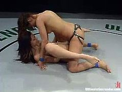 Brunette hotties Isis Love and Satine Phoenix are tussling with each other on tatami. They beat each other and then Isis fucks Satine's cunt with a strapon and pulls the cutie by the hair.