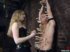 A lot of BDSM tools are being used on this male slave! He is tied up and then this sizzling mistress puts some twitches all over him!