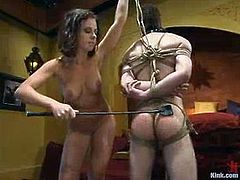 This dude gets tied up and gagged by nasty brunette chick. Then she whips and toys his ass from behind with a strap-on. After that she also tortures and sucks his dick.