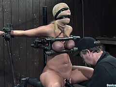 Sexy Mellanie Monroe gets her boobs tortured. Then the master shoves panties in her mouth and toys her vagina.