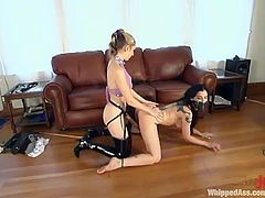 Slim and hot brunette girl gets tied up and undressed by a blonde mistress. Then Shade get her pussy fingered and toyed with a strap-on.