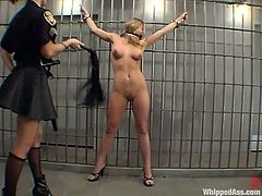 Blonde girl gets whipped and toyed with big dildo by brunette policewoman. After that she also gets pounded with a strap-on.