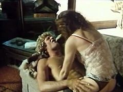 Sexy retro brunette gives her boyfriend eager blowjob and later hops on his dick face to face. Watch this steamy classic porn sex tube video for free.