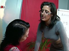 Naughty student and teacher start kissing passionately. The teacher strips her student and applies much oil onto her privates. She then pokes the hole with her fist stretching the hole wide as fuck.