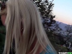 Funky blonde bitch in tight leggings walks on a rocky road and exposes her perky tits on camera. Gal pulls her pants half way down showing off her round butt.