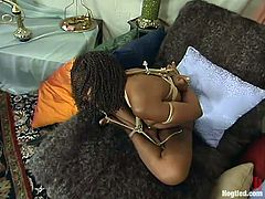 Sexy Black girl lies on a bed and gets toyed by her blonde mistress. After that she gets tied up and toyed in femdom video.