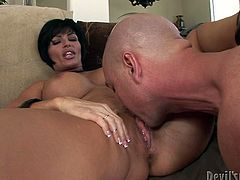 Pretty voluptuous milfie with short black hair and marvelous DD tits gets her shaved pierced pussy licked. Cocky guy pushes her on the couch and fucks her delicious snapper missionary style.