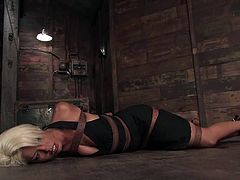 She appears in the scene tied up and in a beautiful, sexy black dress. Her master takes it off and here is she named and all fucked up!