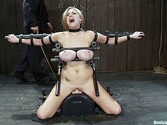 Stunning blonde babe with claws fixed to her huge tits gets bonded. She also gets her pussy toyed by the fucking machine.