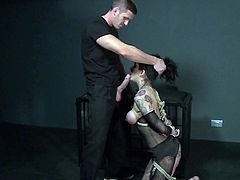 Master Rose has a Russian beauty suspended from the ceiling with ropes. He uses a vibrator on her cunt before he feeds her his big cock. Then he nails her hard.