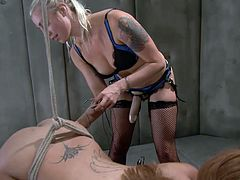 Miss Angel is at our mistresses complete disposal. She stays there tied up and with electrodes on her butt as the sensual blonde mistress Lee plays with her minds and her body. Lee gives Angel her dildo to suck and then, she pounds her shaved pussy. This is just the warm up part so don't miss the shocking action