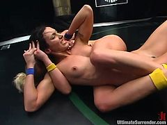 Xana Star and Wenona are having a struggle on tatami. The nude chicks beat each other and then the brunette gets her pussy smashed by her rival.