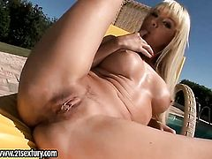 Blonde gives a closeup view of her wet hole while masturbating with dildo