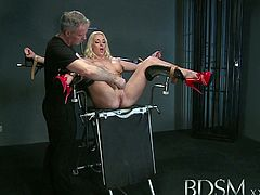 Master White ties this blonde's hands and legs and puts clamps on her nipples. Then, he shoves a vibrator in her cunt and uses another one on her clit. She squirts really fast.