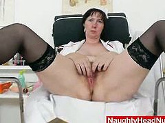 Mature brunette nurse teases with her hairy cunt