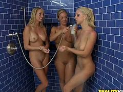 Three blonde babes lick one another's coochies in a bathroom