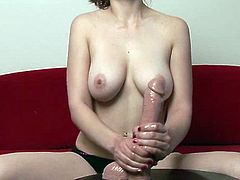 Sexy brunette chick shows her fantastic natural tits for the cam and demonstrates her big realistic dildo. Then she oils the toy and rubs it passionately.