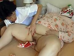 Heavy weight SSBBW granny in glasses pleases her fat snatch with plastic doll. Later one nasty black haired MILF joins her petting her fat twat.