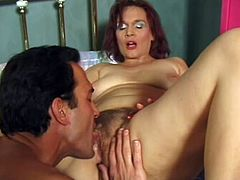 Salacious mature lady Gina Delvaux is having fun with some guy in a bedroom. She shows her cock-sucking skills to the man and then lets him fuck her hairy twat in cowgirl position and cum on her pubis.