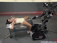 Chubby brunette Sarah Blake is having some good time indoors. She shows off her juicy snatch and gets it drilled deep and hard by a fucking machine.