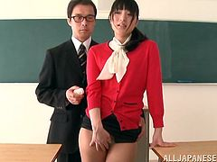 Superb Japanese teacher takes her clothes off in the classroom. She shows her beauties to the whole class and masturbates.