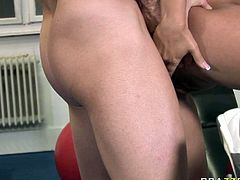 Hot tempered fitness instructor fucks naughty brunette slut right on a fitball. He penetrates her hell working vagina and squeezes her hard and perky nipples.