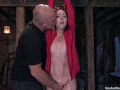 This horny redheads siren is under the wild attitude. She gets naked and tied up, being suspended a bit higher. Then Mark fucks her hot pussy!