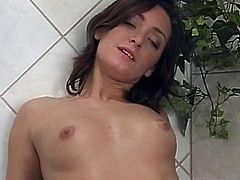 A brunette and a blonde are having lesbian fun in a bathroom. They kiss and hug each other passionately and then pound each other's wet pussies with a dildo.