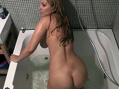 This bitch in the bath is having a good masturbation session. She looks really good naked and looks even better as she gets off.