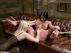 Ashley Fires and Roxanne Hall are playing BDSM games in the living room. The blonde ties the brunette up and beats her ass and legs before fisting her snatch and fucking it with a strapon.