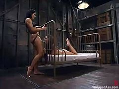 Penny Flame is going to play BDSM games with Sandra Romain. Sandra binds Penny and makes her lick her snatch and then torments her slave and drills her pussy with a dildo.