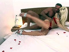 Smoking hot blonde bimbo Stacy Silver with big juicy tits and heavy make up in red underwear and fishnet stockings gets wet twat pounded by tanned hunk in hotel room.