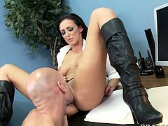 Scorching hot brunette bitch Breanne Benson receives cunnilingus from boss and then takes his big dick up her soaking wet puffy snapper doggystyle.